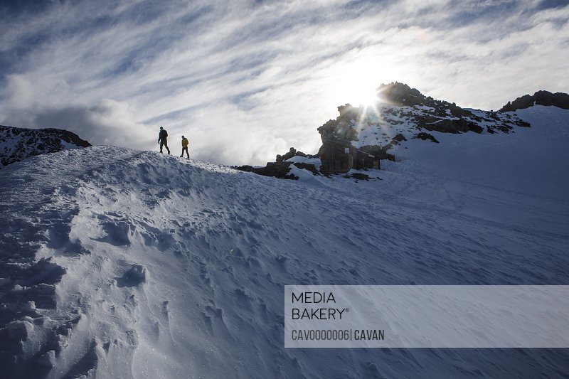 Hikers Walk Along a Ridge in Camp Muir on Mount Rainier<br><br><span style='color: red'>Editorial Use Only.</span><br><br>
