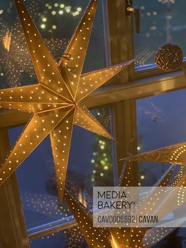 Christmas star hanging in window