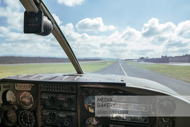 View through front windshield of a small airplane going down runway