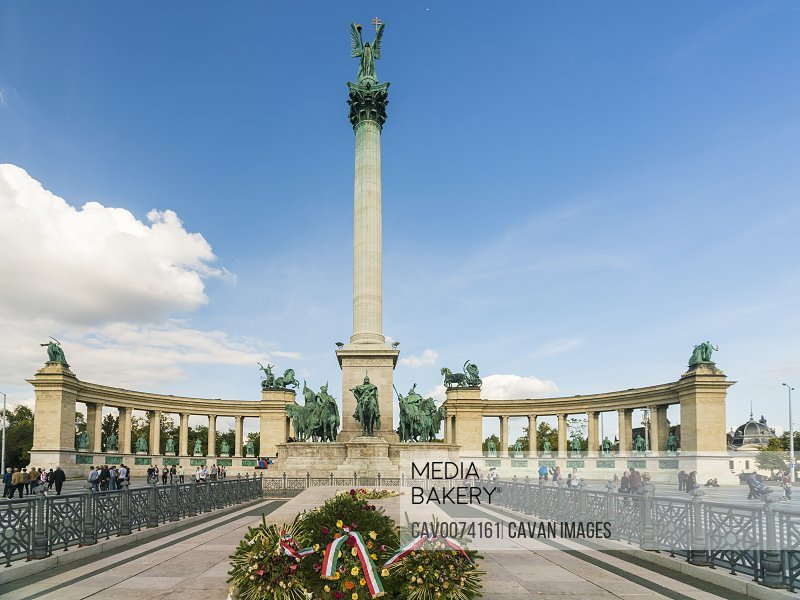 The Millenium Monument in budapest with blue sky and flowers<br><br><span style='color: red'>Editorial Use Only.</span><br><br>