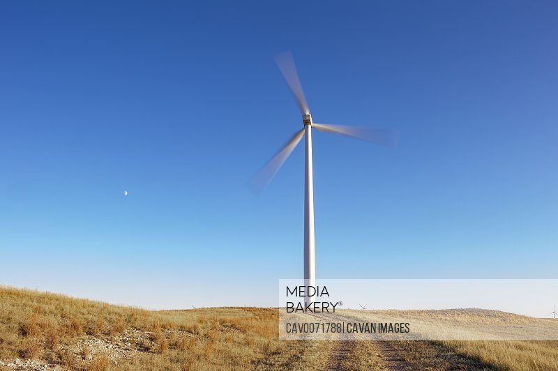 Wind Turbine in motion against blue sky