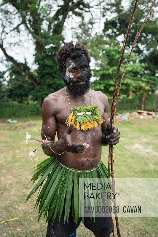Tribesman wearing clothes made with vegetation after the Mask Festival<br><br><span style='color: red'>Editorial Use Only.</span><br><br>