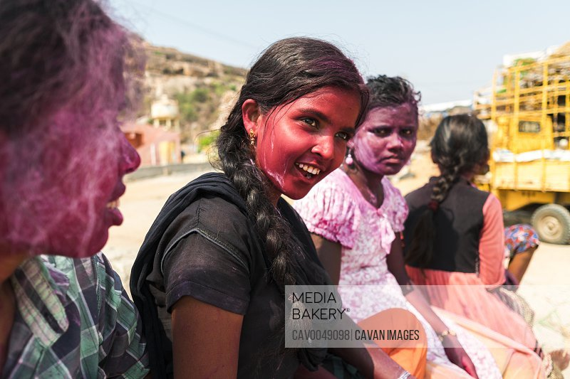 Hampi, India - April 07, 2019: Young indian girls painted in pink pigments celebrating Holy Festival in rural village in Hanuman Halli, Karnataka, India<br><br><span style='color: red'>Editorial Use Only.</span><br><br>