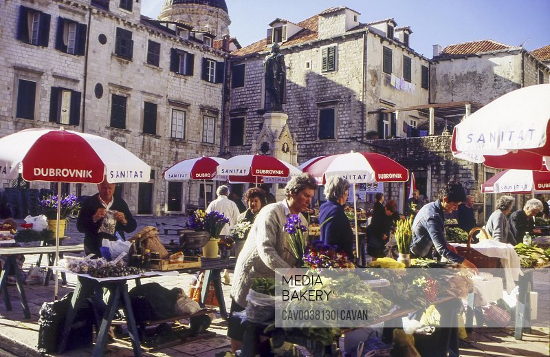 Locals setting up stalls at the open air market in Gunduliceva P<br><br><span style='color: red'>Editorial Use Only.</span><br><br>