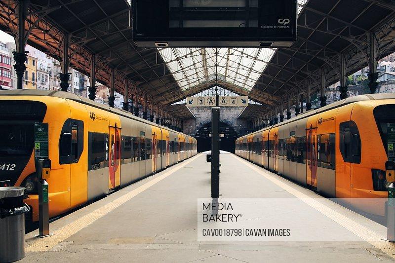 Train station with two yellow trains.<br><br><span style='color: red'>Editorial Use Only.</span><br><br>