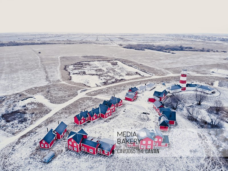 Scenic view of colorful wooden buildings top view. Fishing village and tourist town. Wooden red houses of fishing village in snowy covered in winter. A few red houses near the lighthouse on t<br><br><span style='color: red'>Editorial Use Only.</span><br><br>