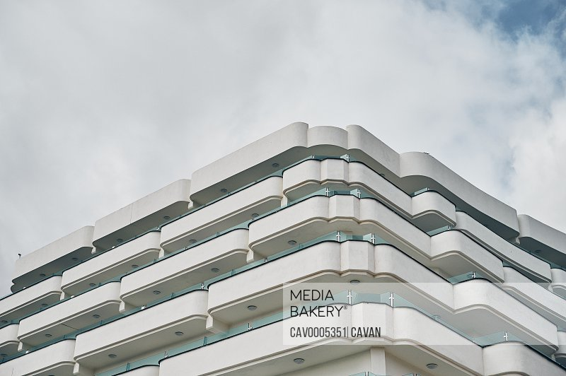 Corner of contemporary building with balconies