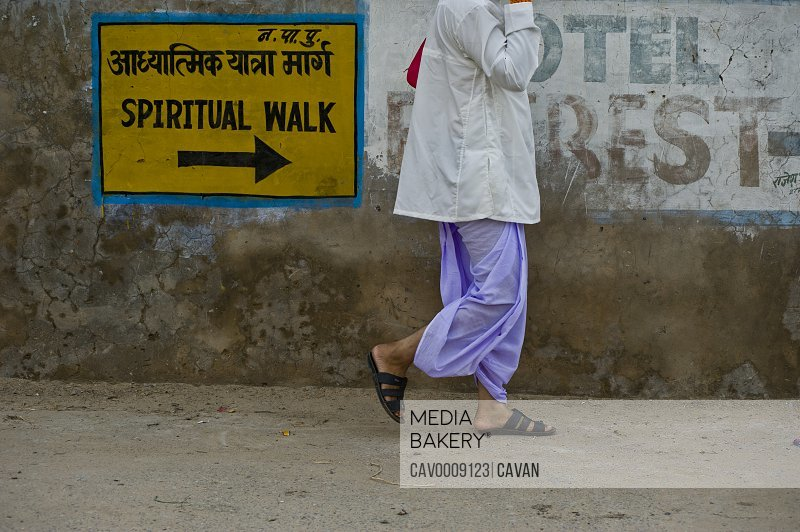 Man with traditional hindu clothes walking <br><br><span style='color: red'>Editorial Use Only.</span><br><br>