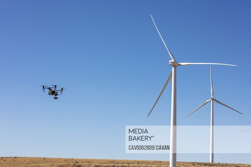 Wind turbines on field with camera drone