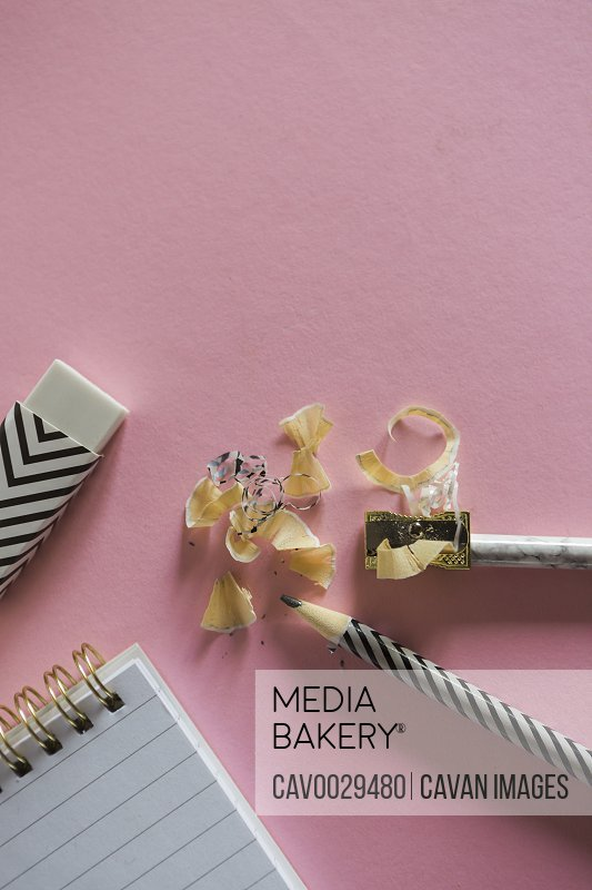 Overhead view of stylish stationery on pink background.