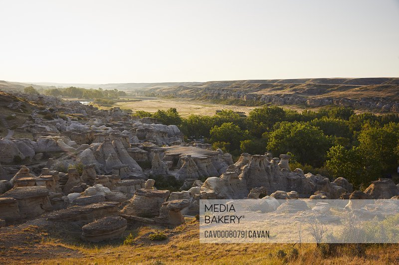 Sandstone formations run through a valley in southern Alberta.