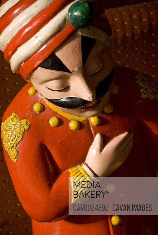 Statue of Rajasthani waiter in restaurant entrance
