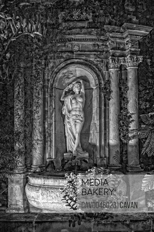Monochrome fountain deity in Valletta