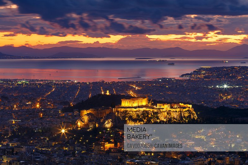 View of Acropolis and city of Athens from Lycabettus hill at sunset.