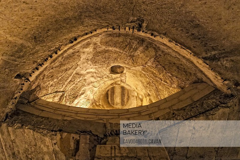 Looking up inside subterranean cistern in Valletta