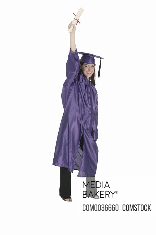 Graduate raising hand in excitement