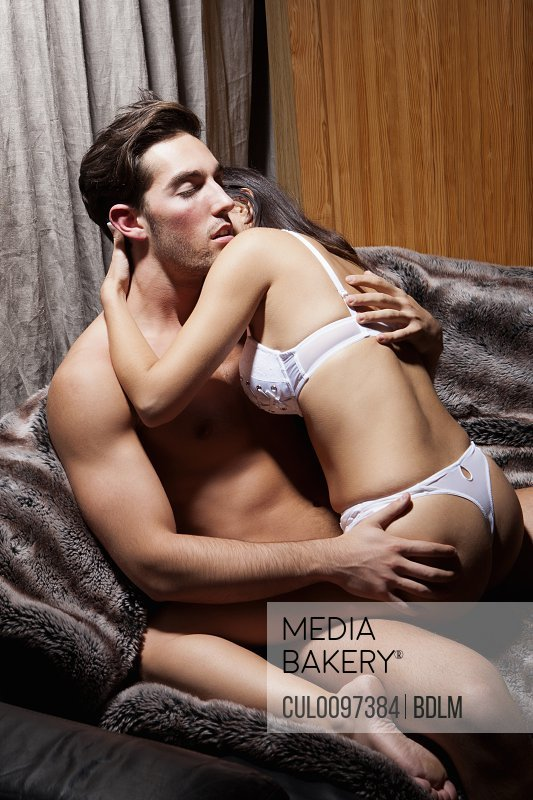 Nude couple kissing