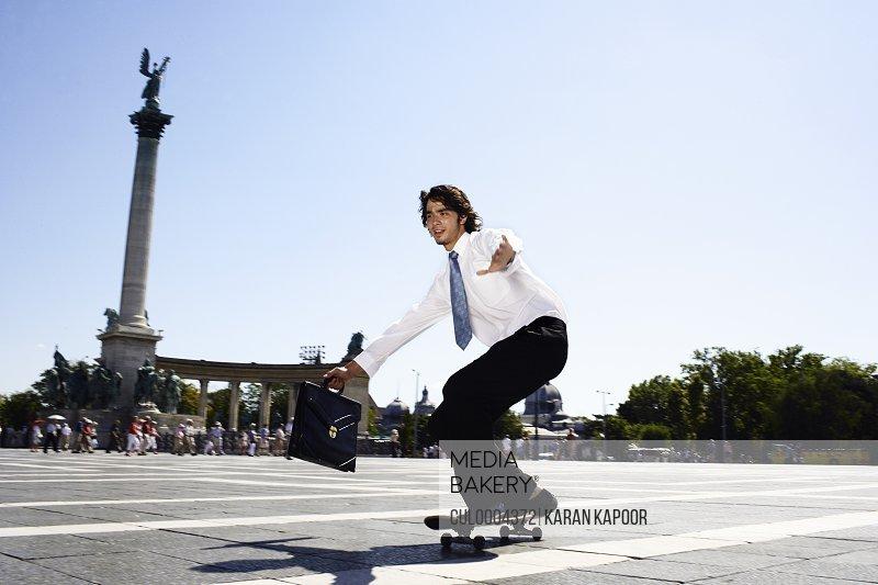 Businessman on skateboard in Hero Square.