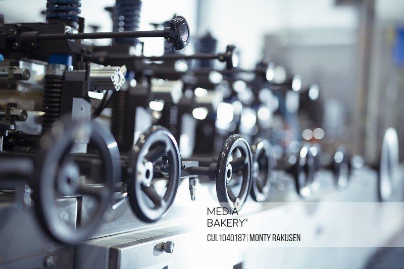 Control wheels on food packaging printing machine in print factory