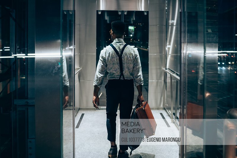 Businessman entering elevator