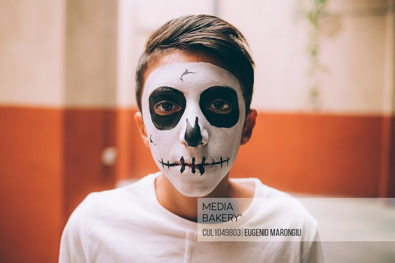 Boy with Halloween skull face paint