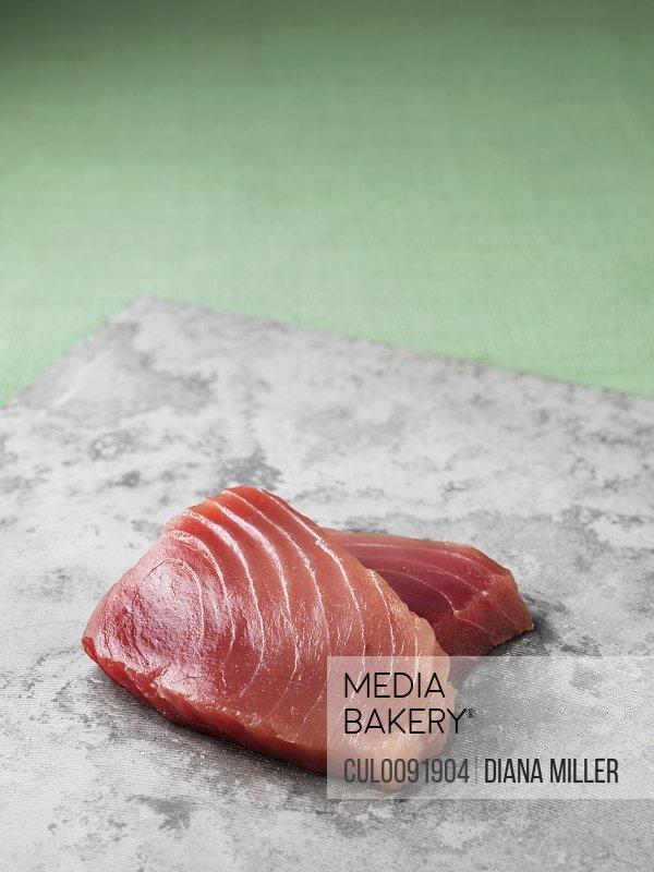 Tuna filets on marble board