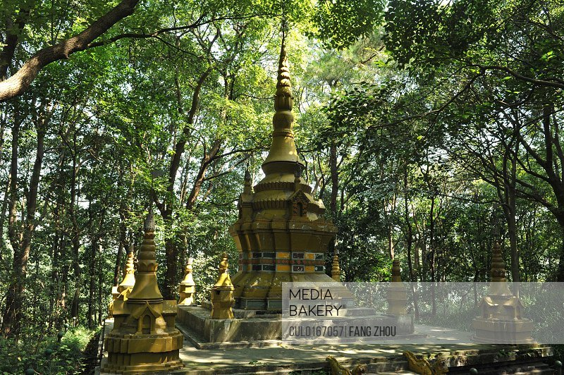 Pagoda in woods in shadow of trees Hangzhou China