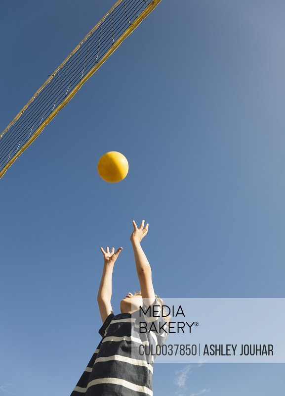 Boy playing volley ball