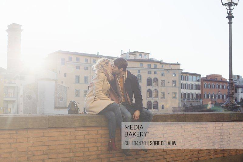 Couple kissing on brick wall, Firenze, Toscana, Italy