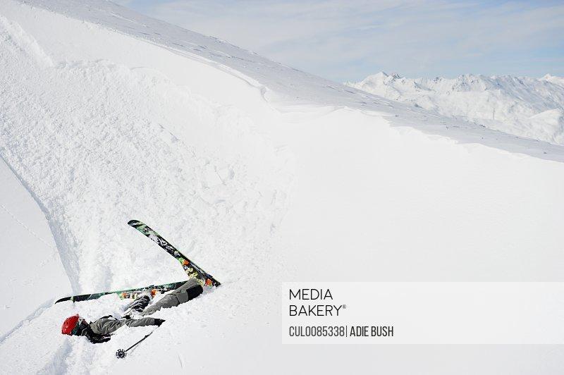 Skier doing flip on snowy slope