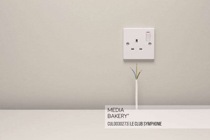 Bare wires by an electrical wall socket