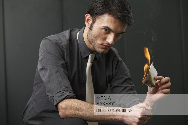 Businessman burning paper