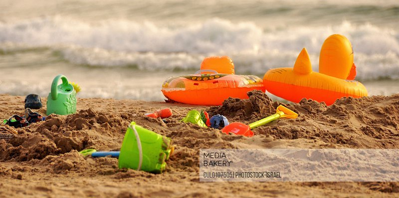 Bucket and spades on sandy beach