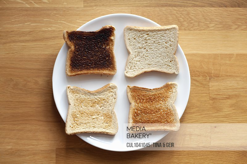 Four sliced bread on plate. Fresh, light toast, crispy toast and burnt