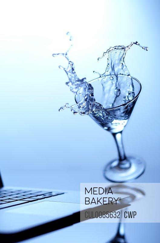 Cocktail spilling on laptop