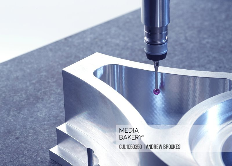 Engineering Metrology, A Property Released (PR)obe from a coordinate measurement machine taking measurements from a engineering part as part of its quality control Property Released (PR)ocess in manufacturing
