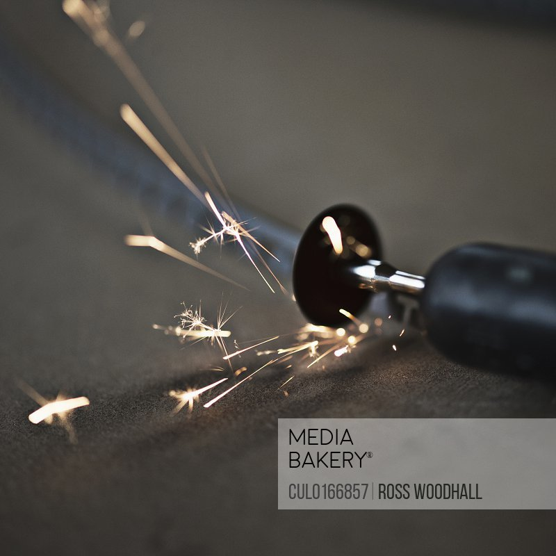 Small disc cutter creating sparks close-up