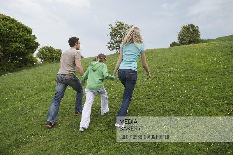 Family walk up hill