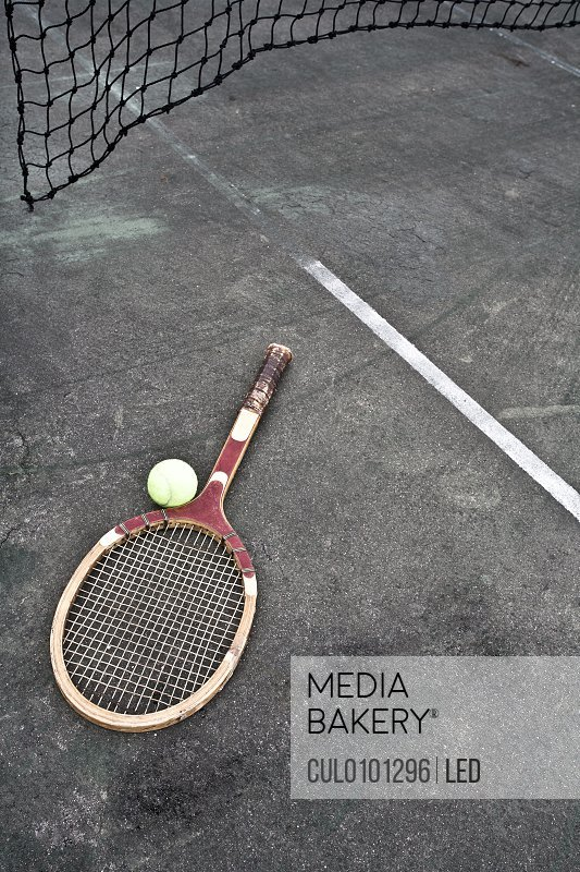 Tennis racket ball on court