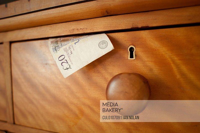 Twenty pound note in drawer close up