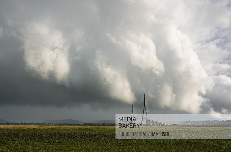 Heavy showers and thunderstorms over the Pont de Normandie bridge, Honfleur, Pas-de-Calais, France