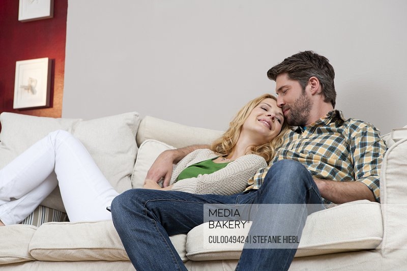 Wife and husband on couch