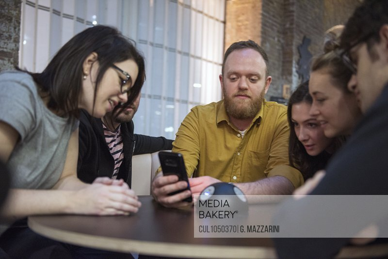 Students looking at smart phone together