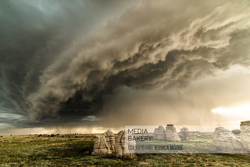 Storm clouds over rock formations in field, Lamar, Colorado, United States, North America