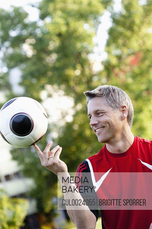 Soccer Player Balancing Ball