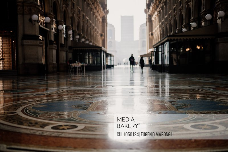 Quiet scene in Galleria Vittorio Emanuele II during 2020 Covid-19 Lockdown, Milan, Italy