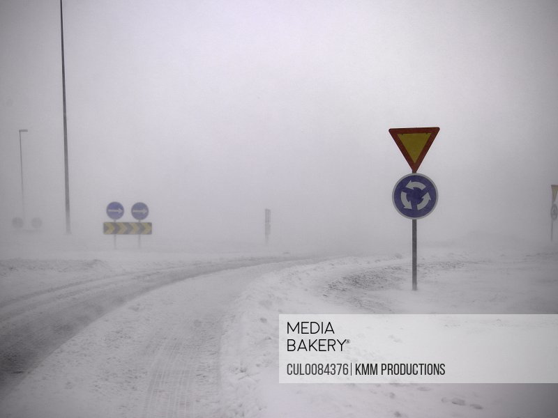 Road signs in snowy landscape