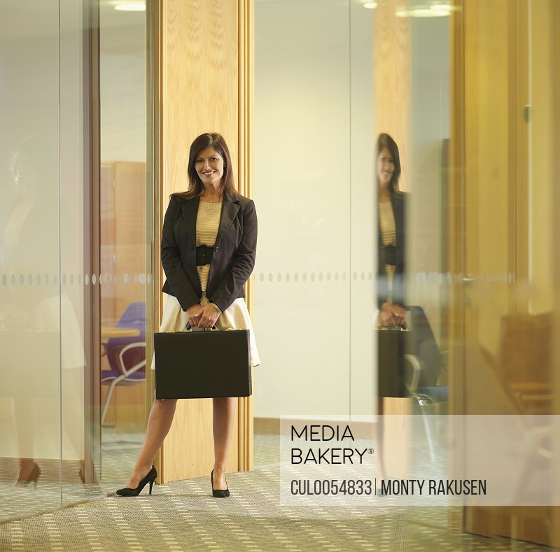 Business women holding briefcase