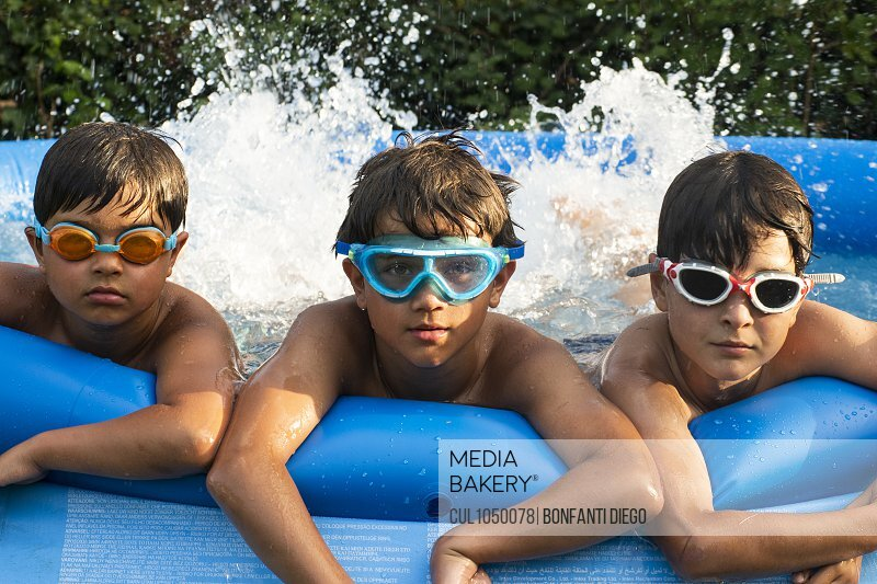 Boys in swimming pool, wearing goggles