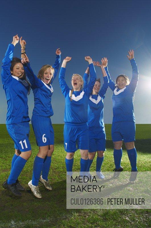 Female football team cheering